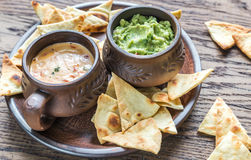 Bowls of guacamole and queso with tortilla chips Royalty Free Stock Photo