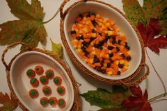 Bowls of Halloween candy corn and pumpkin candy stock image