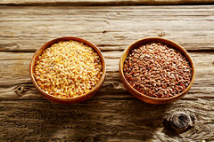 Bowls of healthy long grain and red rice Royalty Free Stock Image