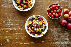 Bowls of heathy organic muesli with fruits on wooden table healthy lifestyle. 
