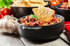 Bowls of hot chili con carne with ground beef, beans, tomatoes and corn Stock Image