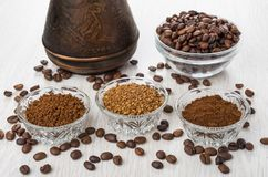 Bowls with instant and ground coffee, coffee beans, turka. On wooden table Stock Image