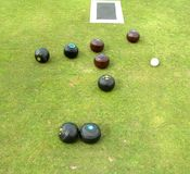 Bowls, jack, and mat lying on bowling green Royalty Free Stock Image