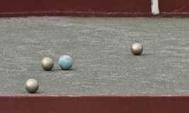 Bowls or lawn bowls is a sport which played outdoor. The objective of the game is to roll balls which is to stop close to one specific ball Royalty Free Stock Images