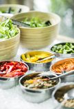 Bowls of mixed fresh organic vegetables in salad bar display. Bowls of mixed fresh organic vegetables in modern salad bar display Royalty Free Stock Photography