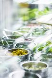 Bowls of mixed fresh organic vegetables in salad bar display. Bowls of mixed fresh organic vegetables in modern salad bar display stock photo