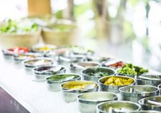 Bowls of mixed fresh organic vegetables in salad bar display. Bowls of mixed fresh organic vegetables in modern salad bar display royalty free stock photos