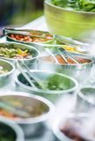 Bowls of mixed fresh organic vegetables in salad bar display. Bowls of mixed fresh organic vegetables in modern salad bar display Stock Image