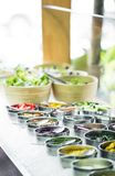 Bowls of mixed fresh organic vegetables in salad bar display. Bowls of mixed fresh organic vegetables in modern salad bar display stock photography