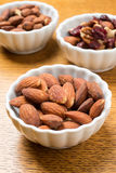 Bowls of nuts at a party. Small snack bowls full of assorted nuts for a party Royalty Free Stock Photos