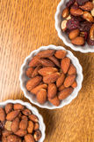 Bowls of nuts. Snack bowls full of an assortment of nuts from above Stock Photography