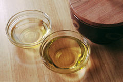 Bowls of oil. On a wooden table Stock Photography