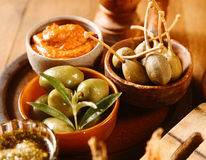 Bowls of olives with savory sauces Stock Image