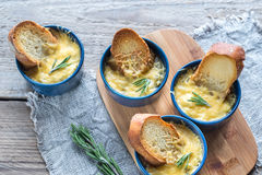 Bowls of onion soup on the wooden board. Top view Royalty Free Stock Photos