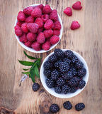 Bowls overflowing with summer berries like Stock Images