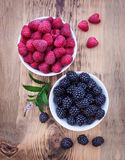 Bowls overflowing with summer berries like Royalty Free Stock Photo