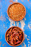 Bowls with paprika and red chilli pepper Stock Images