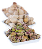Bowls with Pistachios on white Royalty Free Stock Photography