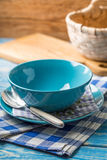 Bowls and plate with spoon. Royalty Free Stock Image