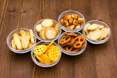 Bowls of pretzels on wood Royalty Free Stock Photo