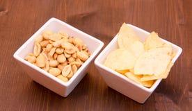 Bowls of pretzels on wood Stock Photo