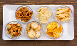 Bowls of pretzels on wooden tray on top Stock Photos