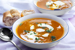 Bowls of Pumpkin Soup with Bread. Bowls of home-cooked pumpkin soup, with fresh bread Royalty Free Stock Images