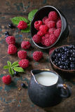 Bowls of raspberries and blueberries Royalty Free Stock Photography