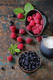 Bowls of raspberries and blueberries Stock Photos