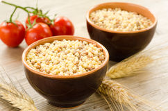 Bowls of raw fregola Royalty Free Stock Photo