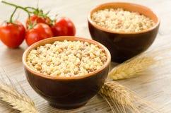 Bowls of raw fregola Royalty Free Stock Photo