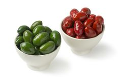 Bowls with red and green Italan Bella olives. Isolated on white background stock image