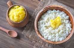 Bowls of rice and Ghee clarified butter. On the wooden table Royalty Free Stock Images