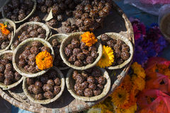 Bowls with saffron water and flowers at Bodhnath stupa in Kathma Royalty Free Stock Photo