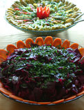 Bowls of salad. Two bowls of food containing vegetable salads, beetroot and carrots Royalty Free Stock Photo