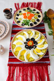 Bowls of salad with mayonnaise, vegetables and eggs, Russian Olivier salad or Romanian Boeuf salad Royalty Free Stock Images
