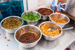 Bowls with seasonings, spices and toppings Stock Image