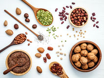 Bowls and spoons of various legumes and different kinds of nuts Stock Image