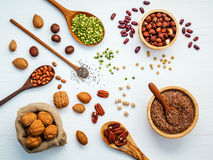 Bowls and spoons of various legumes and different kinds of nuts Stock Photography