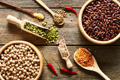 Bowls and spoons of various legumes Royalty Free Stock Image