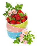Bowls with strawberries and flowers decoration Royalty Free Stock Photo