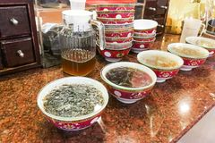 Bowls of Therapeutic traditional Chinese medicine soup tea at re. Bowls of Therapeutic traditional Chinese medicine soup or tea for minor illness like cough, flu Royalty Free Stock Photos