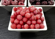Bowls with three kinds of frozen berries Royalty Free Stock Photos