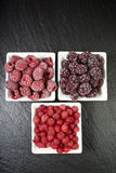 Bowls with three kinds of frozen berries Royalty Free Stock Photography