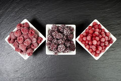 Bowls with three kinds of frozen berries Royalty Free Stock Images