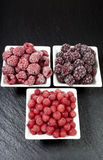 Bowls with three kinds of frozen berries Royalty Free Stock Image