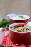 Bowls of uncooked rice and chili peppers Royalty Free Stock Photo