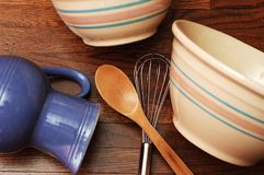 Bowls and Utensils. Common kitchen items: mixing bowls, a pitcher, wisk and wooden spoon Stock Photo