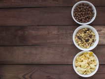 Bowls of various cereals  from top view . Wooden baclground Stock Image