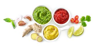 Bowls of various sauces. Isolated on white background, top view stock photo